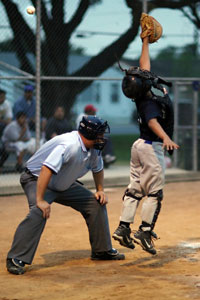 catcher reaching for a pitch