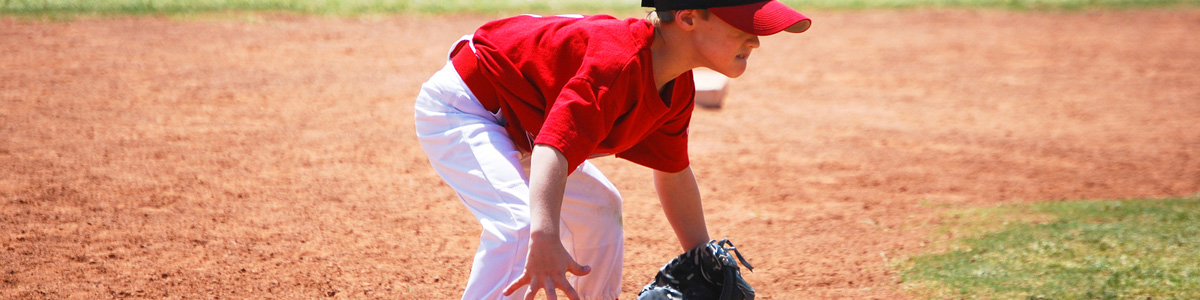 Young player ready to field a ground ball